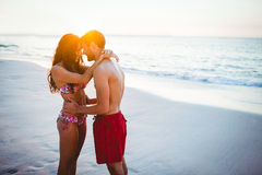 Smiling couple facing each other on the beach Royalty Free Stock Images