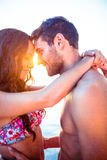 Smiling couple facing each other on the beach Royalty Free Stock Photo