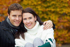Smiling couple in fall stock images