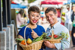 Smiling Couple at Farmers Market Royalty Free Stock Images