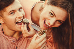 Smiling couple feeding each other. Royalty Free Stock Photo