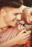 Smiling couple feeding each other. Royalty Free Stock Photography
