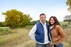 Smiling couple in field Stock Photos