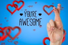 Smiling couple fingers with digitally generated hearts and message Royalty Free Stock Images