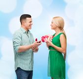 Smiling couple with flower bouquet and ring Stock Photography