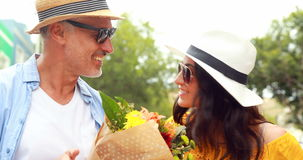 Smiling couple with flowers stock footage