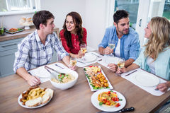 Smiling couple friends eating together Royalty Free Stock Image