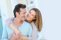 Smiling couple in front of the house Stock Photos