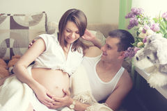 Smiling couple future parents relaxing. Royalty Free Stock Image