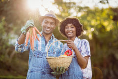 Smiling couple in the garden Royalty Free Stock Images