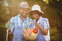 Smiling couple in the garden Stock Photos