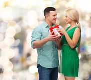 Smiling couple with gift box Stock Image