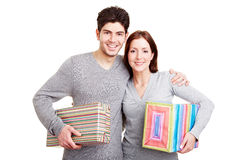 Smiling couple with gifts Royalty Free Stock Photo