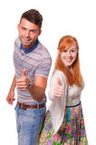 Smiling couple give thumbs up Royalty Free Stock Photos