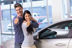 Smiling couple giving thumbs up Stock Photo