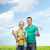 Smiling couple in gloves with paint rollers Stock Image