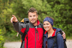 Smiling couple going on a hike together looking ahead Stock Photography