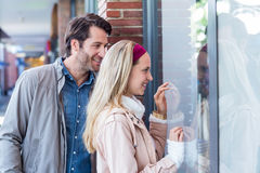 Smiling couple going window shopping Stock Image
