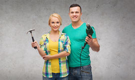 Smiling couple with hammer and drill Royalty Free Stock Photo
