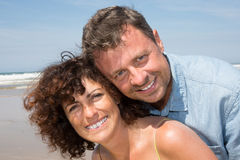 Smiling couple happy at beautiful summer beach Royalty Free Stock Images