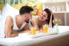 Couple have romantic breakfast in bed. Smiling couple have romantic breakfast in bed Stock Photo