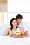 Smiling couple having breakfast Royalty Free Stock Photo