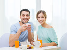 Smiling couple having breakfast at home Royalty Free Stock Photo