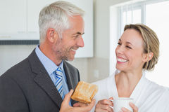 Smiling couple having breakfast in the morning before work Stock Photo
