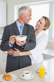 Smiling couple having breakfast in the morning before work Royalty Free Stock Images