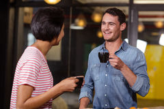 Smiling couple having coffee royalty free stock photography