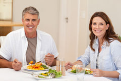 Smiling couple having dinner Stock Photography