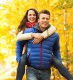 Smiling couple having fun in autumn park Stock Photo