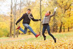 Smiling couple having fun in autumn park Royalty Free Stock Photography