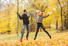 Smiling couple having fun in autumn park Stock Photos