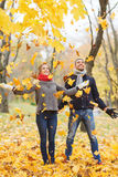 Smiling couple having fun in autumn park Royalty Free Stock Image