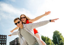 Smiling couple having fun in city Stock Photography