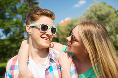Smiling couple having fun outdoors. Holidays, vacation, love and friendship concept - smiling couple having fun outdoors Stock Photo
