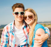 Smiling couple having fun outdoors. Holidays, vacation, love and friendship concept - smiling couple having fun outdoors Royalty Free Stock Photography