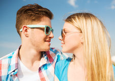 Smiling couple having fun outdoors. Holidays, vacation, love and friendship concept - smiling couple having fun outdoors Stock Photos