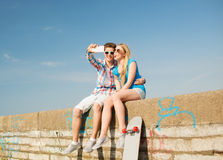 Smiling couple having fun outdoors Royalty Free Stock Photo