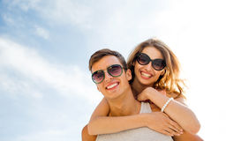 Smiling couple having fun over sky background Stock Photo