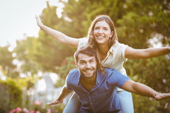 Smiling couple having fun. At park royalty free stock image
