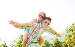 Smiling couple having fun in park Royalty Free Stock Images