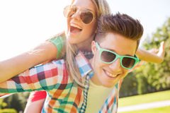 Smiling couple having fun in park Stock Image