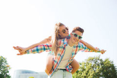 Smiling couple having fun in park Royalty Free Stock Photography