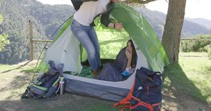 Smiling couple having fun in tent stock footage