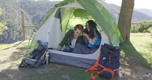 Smiling couple having fun in tent Stock Photography