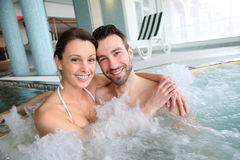 Smiling couple having a good time in jacuzzi Stock Photo