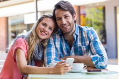 Smiling couple having tea in a cafe Stock Image