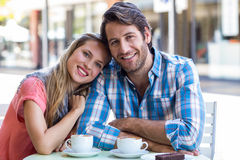 Smiling couple having tea in a cafe Royalty Free Stock Photo